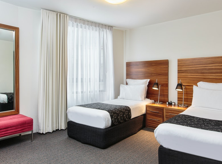 A picture of a modern hotel room at Cambridge Hotel Sydney