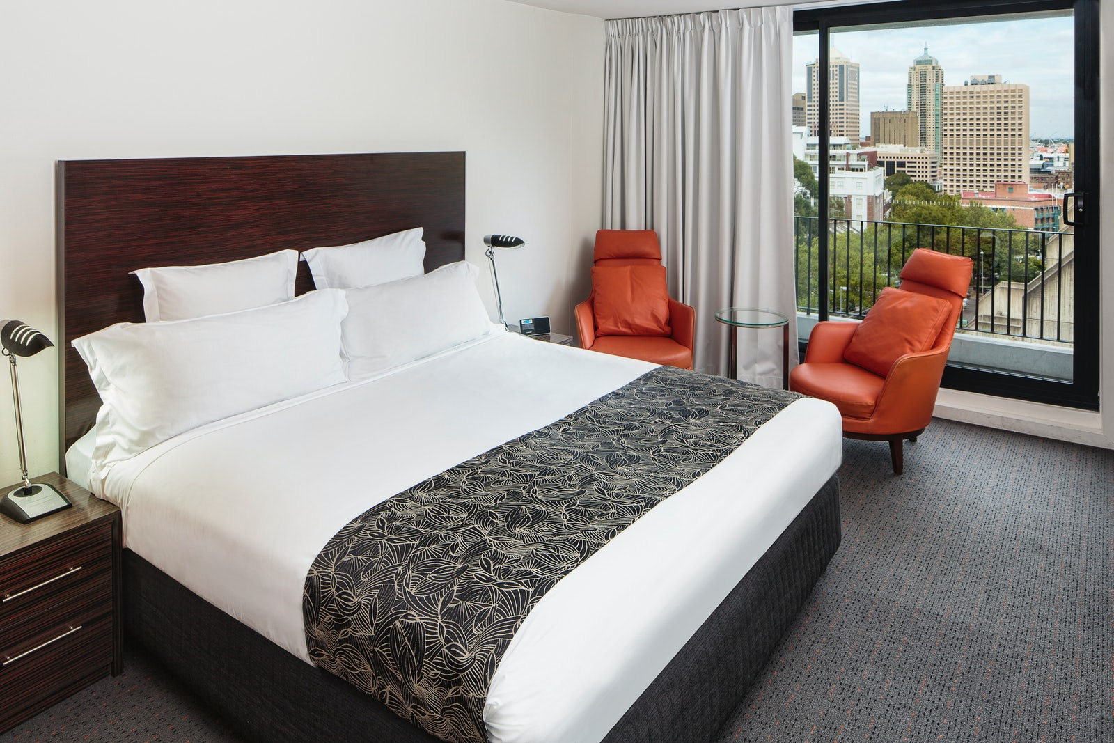 A picture of a King Room with a balcony at Cambridge Hotel in Surry Hills Sydney