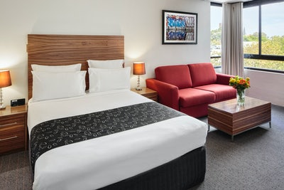 A picture of a bedroom suite at Cambridge hotel Surry Hills