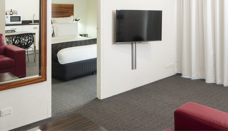 a picture of a one bedroom deluxe at the Cambridge Hotel in Sydney Surry Hills