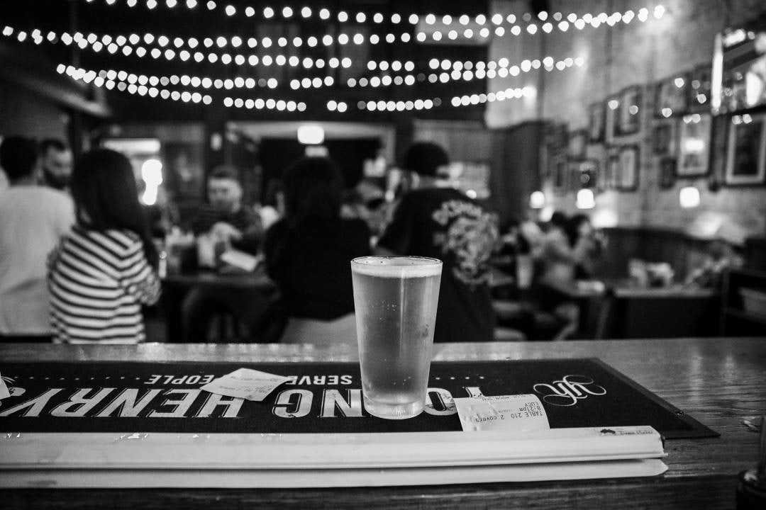 A picture of a cold beer and food at Surly's American Diner near Riley Street